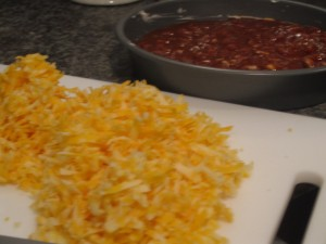 thank you S for grating the cheese so nicely, and KP for plopping the chili into the pan!